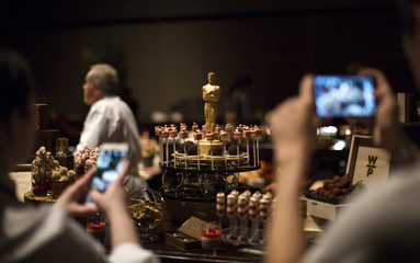 Oscar shaped chocolate along with other desserts is pictured during preview of food and decor for 87th Academy Awards' Governors Ball at Ray Dolby ballroom in Hollywood