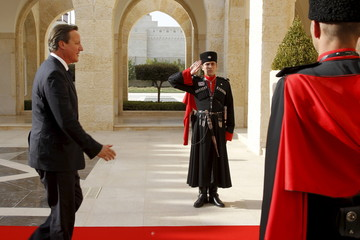 British Prime Minister David Cameron arrives to meet Jordan's King Abdullah at the Royal Palace in Amman