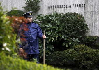 Police officer stands guard in front of the French embassy in Tokyo