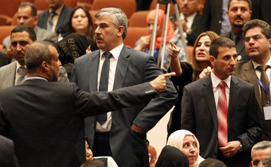 Members of the newly elected Iraqi parliament point fingers after an argument broke out at the parliament headquarters in Baghdad