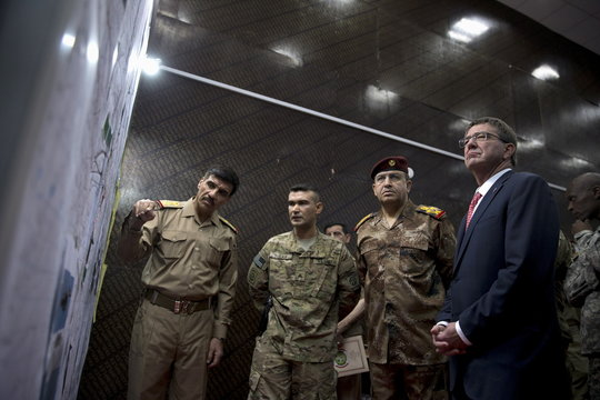 U.S. Defense Secretary Ash Carter and Iraqi Gen. Taleb Shegati Al-Kenani, the commander of the Counter Terrorism Service look over diagrams and maps at the Combined Joint Operations Center in Baghdad