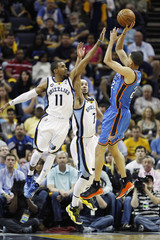 Thunder guard Martin shoots over Grizzlies guards Conley and Bayless during second half action of game three in the Western Conference semifinals of the NBA playoffs in Memphis