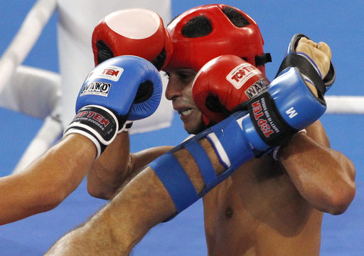 Abdella of France tries to defend himself as he fights Abdulmedzhidov of Russia during their semi-final bout in the low-kick 67kg kickboxing competition at the Combat Games in Beijing