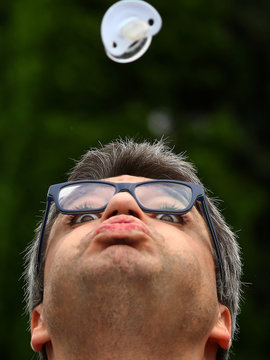 Boris Meinzer, founder of the pacifier spitting World Championships takes part in this year's competition in Nidderau near Frankfurt