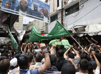 Sabiha is carried by colleagues and friends during his funeral in Ain al-Hilweh Palestinian refugee camp near the port-city of Sidon, in south Lebanon