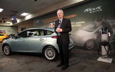 Ford Motor Group Vice President of Global Product Development Derrick Kuzak stands next to a Ford Focus Electric as he talks about electric vehicle manufacturing during a news conference at the Ford Michigan Assembly Plant in Wayne,