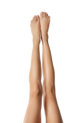 Legs of beautiful young woman on white background. Epilation concept