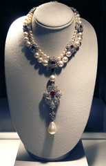 A ruby, diamond and pearl necklace by Cartier with the La Peregrina natural pearl pendant is pictured at the press preview for Christie's auction of The Collection of Elizabeth Taylor at MOCA Pacific Design Center in Los Angeles