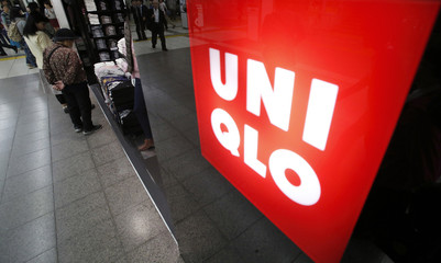 Shoppers look at items at Fast Retailing's Uniqlo casual clothing store in Tokyo