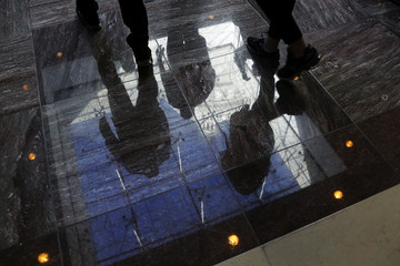 The U.S. Capitol dome is reflected on the stone floor as visitors take an official tour, which had been suspended during the 16-day government shutdown, at the U.S. Capitol in Washington