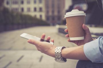 Beautiful girl in the city drinking coffee