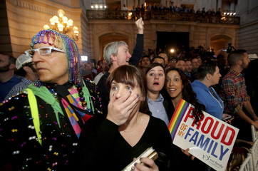 People react at the city hall in San Francisco after the U.S. Supreme Court ruled on California's Proposition 8 and the federal Defense of Marriage Act
