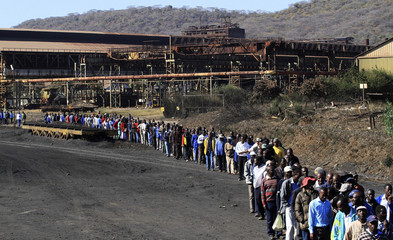 Workers from ZISCO walk to the company's new steel and mineral plant in Redcliff, Kwekwe