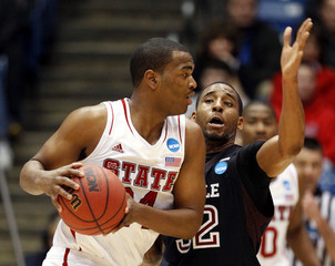 North Carolina State Wolfpack forward Warren is pressured by Temple Owls forward Hollis-Jefferson during the first half of their second round NCAA tournament basketball game in Dayton