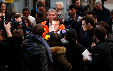 Macron candidate for the 2017 French presidential visits a qualification class for refugees of German railway operator Deutsche Bahn in Berlin