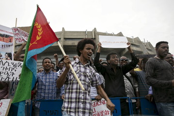 Eritrean refugees stage a protest against the Eritrean government outside their embassy in Tel Aviv, Israel