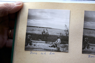 Lindberg shows a black and white family photo from the early 1960s of two girls playing in a sandpit that used to be at his parents' summer cottage near Lulea.