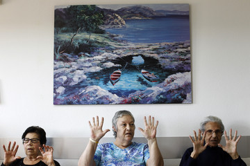 Residents do exercises during an occupational therapy class at the Virgen del Carmen geriatric home in Peleas de Abajo, in northwestern Spain