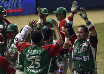 Mexico's Garcia celebrates his solo home run solo against Dominican Republic with teammates during their game of Caribbean Baseball series in Mayaguez