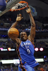 Oklahoma City Thunder's Ibaka dunks the ball against the Dallas Mavericks during their NBA Western Conference quarter-final playoff basketball game in Dallas