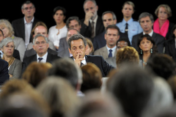 France's President Sarkozy attends a meeting with teachers and staff after he visited a school in Plaisir, near Paris