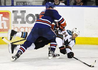 Edmonton Oilers' Smid hits San Jose Sharks' Winnik during their NHL hockey game in Edmonton
