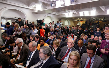Journalists wait for U.S. President Barack Obama to start his annual year-end news conference
