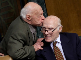 Actor Mickey Rooney kisses the head of Senator Herb Kohl (D-WI) as he leaves a special hearing on elder abuse, neglect and financial exploitation on Capitol Hill in Washington