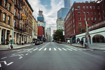 New York City street road in Manhattan at summer time. Urban big city life concept background. Fototapete