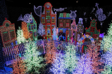 People tour a Christmas attraction featuring a display of more than 800,000 light bulbs in Universal Studios Singapore
