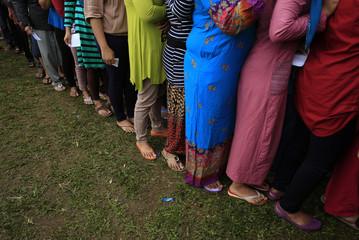 Villagers line up to vote during the presidential election at Bojong Koneng polling station in Bogor