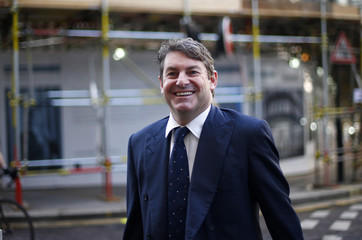 Charlie Brooks, husband of former News International executive Rebekah Brooks, arrives at Old Bailey in central London