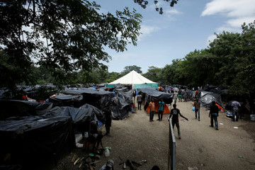 Afrinan migrants stranded in Costa Rica, walk at makeshift camp at the border between Costa Rica and Nicaragua, in Penas Blancas