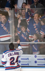 New York Rangers Callahan toss puck to fans after four goal game against against Philadelphia Flyers in New York