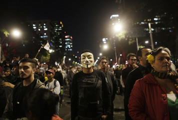 Demonstrator wearing a Guy Fawkes mask participates in a protest in support of the 43 missing trainee teachers in Mexico City