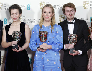 """Majka, Jacobs and Hees celebrate after winning best short animation film for """"The Bigger Picture"""" at the BAFTA awards in London"""