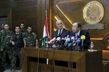 United Nations Secretary-General Ban Ki-moon (R) talks during a news conference next to Lebanese Deputy Prime Minister and Defense Minister Samir Moqbel (2nd R) at the Ministry of Defense in Yarze, east of Beirut
