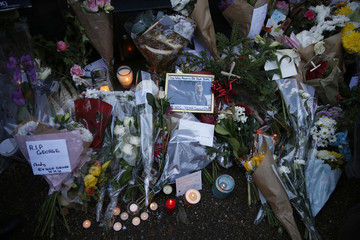 Tributes are seen outside the house of singer George Michael, in north London