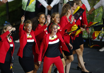 Belgium's athletes wave as they march on the parade during the opening ceremony of the London 2012 Olympic Games