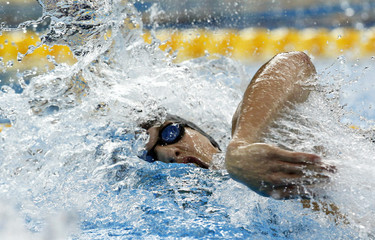 Hungary's Kozma competes in men's 100m freestyle heats at 14th FINA World Championships in Shanghai