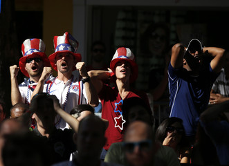 A group of U.S fans reacts as they watch the broadcast of the 2014 World Cup Group G soccer match between the U.S. and Germany in Belo Horizonte