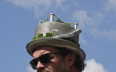A visitor wears a floral design hat at the Chelsea Flower Show in London, Britain