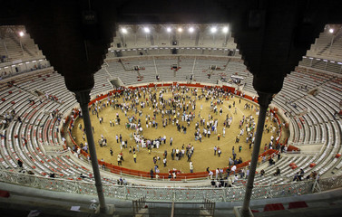 People jump to the Monumental's bullring arena after the last bullfight in central Barcelona