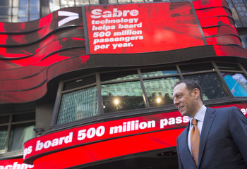 Tom Klein, Chief Executive Officer and President of Sabre Corporation poses for photos following Sabre's opening of trading at the NASDAQ MarketSite in Times Square in celebration of Sabre Corporation's initial public offering (IPO) on The NASDAQ Stock Mar