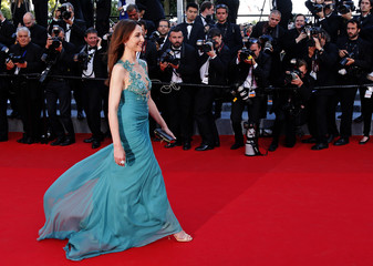 "Actress Elsa Zylberstein poses on the red carpet as she arrives for the screening of the film ""Deux jours, une nuit"" at the 67th Cannes Film Festival in Cannes"