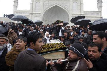 Afghans carry the coffin of Afghan journalist Sardar Ahmad of Agence France-Presse, during his funeral ceremony in Kabul