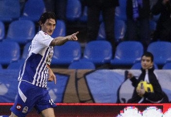 Deportivo Coruna's Diego Colotto celebrates his goal against Malaga during their Spanish First Division soccer match in Coruna