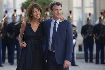 French actor Francois Cluzet and his wife Narjiss arrive at the Elysee Palace in Paris