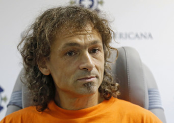 Lopez-Tercero talks during a news conference at a clinic in Lima