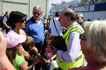 """The British Consul in Bilbao Derek Doyle helps passengers stranded by flight cancellations as they wait to board the """"Pride of Bilbao"""" ferry in the Spanish Basque port of Santurce."""